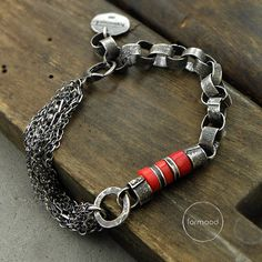 Bracelet is made of oxidized and rubbed silver 925, and coral approx. 8 mm (0.31 inches) in diameter. This one of a kind chain is handmade, the