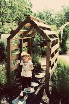 Pallets tunnel. This would look great with some vines growing on it! How beautiful!