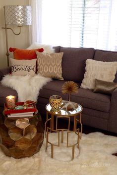 We couldn't resist this orange velvet pillow with pom-poms when we saw it  at HomeGoods! It was the starting point for decorating this sofa for fall.