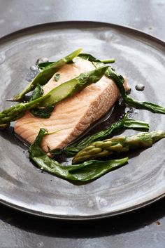 This sounds so moist and delicious ––– Salmon cooked in rapeseed oil with asparagus and wild garlic.