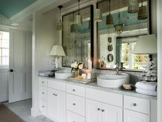 This bathroom uses up-light and low lights to illuminate the vanity. Table lamps aren't often thought of for the bathroom, but why not give it a try.  You can always move them back into the living room if they don't work.