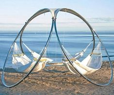 The Trinity Infinity Hammock is a hammock setup for three. The frame is made from long lasting stainless steel, and the hammocks are made from quilted Sunbrella outdoor fabric. Each hammock can hold up to 440 lbs, so if you start that diet you should be able to use it soon.