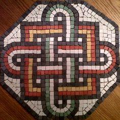 Solomon's knot with interwoven square. Notice it's slightly off centre!