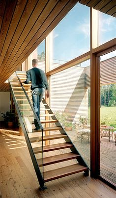 Elegant stairs in an Austrian wooden house designed by architect Daniel Sauter of K_M Architektur