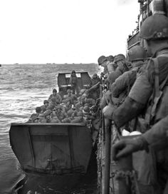US troops disembark from a landing craft infantry (LCI), which carried 250 men fully equipped into a LCA, which transported 35 men to the beach. #WWII #history #Normandy #OmahaBeach   Source – Army: An Illustrated History