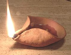 "Replica of olive oil lamp 1500 BC. Any mechanism that will keep about 1/4"" of wick elevated above the oil will work."
