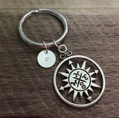Hey, I found this really awesome Etsy listing at https://www.etsy.com/listing/223609373/mens-compass-initial-keychain-for-men