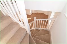 Pershore Staircase - white primed softwood flight of stairs with a double winder leading to a first floor with a return balustrade.