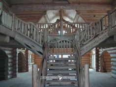 Double staircase with character railing.  By Caribou Creek Log & Timber