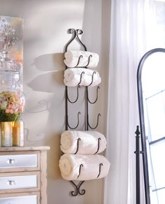 Don't buy gifts that aren't useful. Give your loved ones something that enhance their lives, like this Bronze Metal Hanging Towel Rack that's under $25.