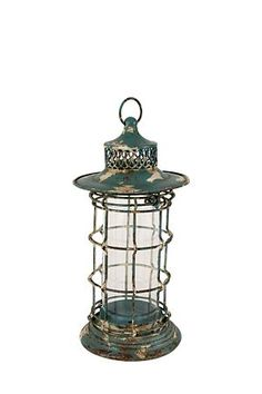 """This metal and glass lantern with a distressed paint finish can be used with a pillar candle to add a warm glow to your rustic inspired setting. Ideal for complimenting your coastal interior or to add brightness when entertaining guests outdoors.<div class=""""pdpDescContent""""><BR /><b class=""""pdpDesc"""">Dimensions:</b><BR />L18.5xW18.5xH39 cm</div>"""
