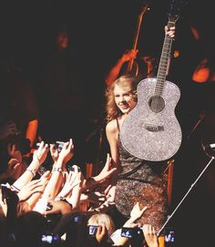 Taylor Swift a friend of mine's dad almost flew her in a airplane! she passed out free guitars and autographs! I know talk about wish I was there! Just being able to meet hear or even see her would be totally to cool!