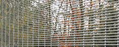 A white color powder coated 3510 mesh fence is installed to isolate the forest and factory.