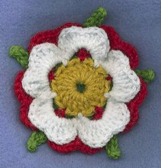crocheted Tudor Rose -- A blending of the red for Sommerset and the white for York, I believe.  The Tudor family brought the two warring families together.