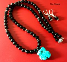 Beautifully hand crafted Black Jade necklace set (Includes Earrings) garnished with Turquoise Pendant with magnetic hook designed by TheShobs makes it easy to wear, Unique design for the unique you.62 cm in length and  74gm.