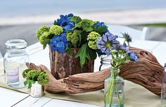 Driftwood and floral centerpiece for beach wedding