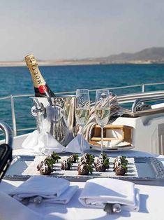Un yate es la opción perfecta para una escapada romántica - Visit www.clubwearcentral.com for the hottest yacht party bikinis.