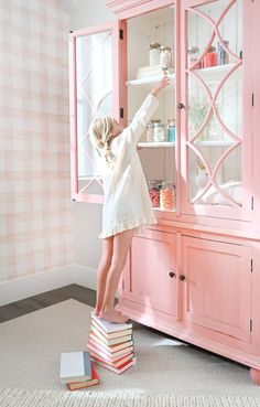 """A bubblegum pink """"candy cupboard"""" in the girls' room."""