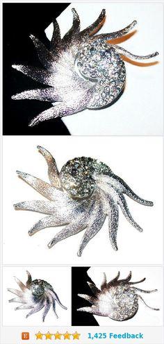 "Eisenberg Ice Rhinestone Brooch Signed Octopus? Silver Metal 2 1/4"" Vintage https://www.etsy.com/BrightgemsTreasures/listing/544631994/eisenberg-ice-rhinestone-brooch-signed?ref=shop_home_active_1"