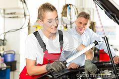 Mature man and female car mechanic in workshop by Arne9001, via Dreamstime