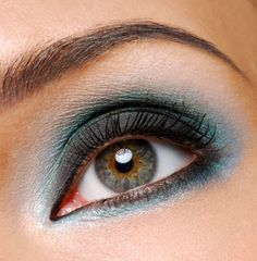 You have green/hazel eyes  Golden browns, warm taupes, deep purples, soft peaches, pink, gold and soft violets work well.  To find what brings out hazel eyes, look at the flecks of colour near the pupil. This is my eye colouring and I find that copper looks stunning as well as a navy blue or green (as long as it is not too vivid).