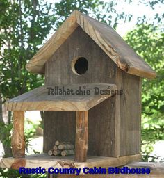 Rustic Country Cabin Birdhouse made from real southern reclaimed barnwood. Cabin is in the style of Southern days gone by. Here in the south we look forward to neighbors stopping by to set a spell. Adds a rustic nostalgic touch to any yard, garden, deck or porch. This rustic birdhouse is crafted from old reclaimed weathered barnwood from Mississippi buildings & structures. Built to withstand the outdoor elements and can easily be mounted anywhere. A stack of firewood is on the porch. You ...