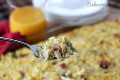 This Sunday Brunch Casserole recipe is a hearty egg, hashbrown, bacon and cheese dish to feed a crowd. Make it the day of or ahead. Bakerette.com