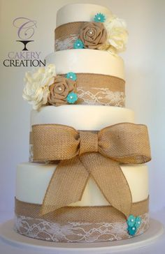 Wedding cake that uses Tiffany blue, lace, and burlap
