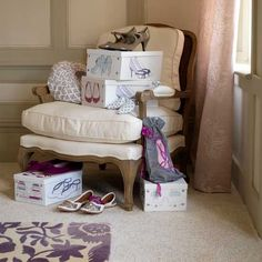 Shoe storage boxes on a fabric chair