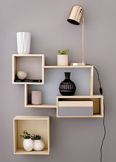 MODULAR DISPLAY BOXES, £179 for a set of three; COPPER TABLE LAMP, £219, and VASES, from £7.50 each, all Bloomingville, bloomingville.com