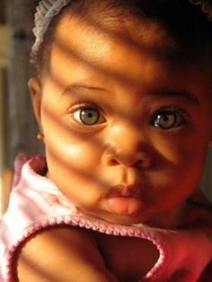 GORGEOUS baby with beautiful blue eyes!