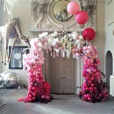 We're in love with this ombre-pink balloon and flower arch that will guide your guests into your reception room. It's a stunning, Insta-worthy spot for the couple to pose in front of and a fantastic talking point! Combine it with a really unusual touch, like this giant giraffe balloon, for the most memorable entrance your guests will ever have seen.