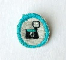 Merit Badge – Diana Camera