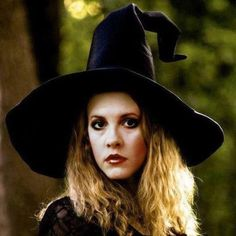 serious Stevie  ~ ☆♥❤♥☆ ~   wearing a cool black witch's hat ~ love her heavy eye makeup here