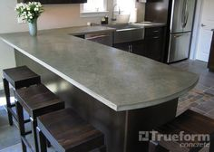 This contemporary and unique counter is a concrete kitchen countertop. Concrete Countertops -Trueform Concrete Custom Work