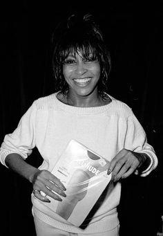 American RB Rock and Pop musician Tina Turner smiles as she holds a package pair of pantyhose backstage at the Ritz New York New York May 7 1981 She...