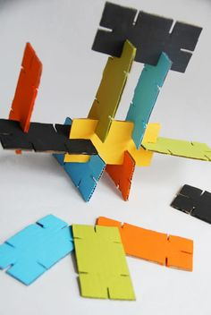 Indoor activity: make cardboard stackers.  Wonder if I could do this with paint colour cards... or maybe they would be too thin...