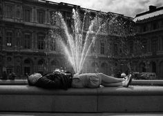 I was with my children when I saw this tourist. He was lying at the fountain of the castle of the Louvre. He was snoring. He had to be very tired. And then I saw the water jet. I'm sorry for this picture. Street photography a bit of fun too, isn't it?