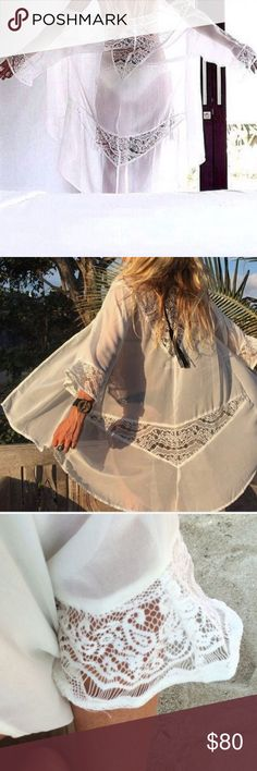 NWOT Kivari Moonlight white kimono w/ lace detail NWOT Kivari Moonlight white kimono w/ lace detail.  Note: brand is Kivari NOT SPELL & THE GYPSY.  Like Arnhem and Free people. Spell & The Gypsy Collective Tops