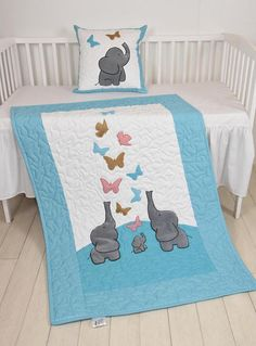 The cute elephant baby blankets nice for boys too, with different colours of course. I used the timeless chevron pattern, and made the applications with patchwork technique. Can be made any size and colour, or with different applications. On this custom made quilt set each applique