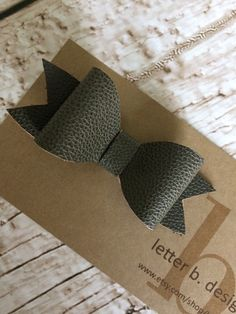 Dark Gray Textured Leather Hair Bow on Alligator Clip  by letterbdesigns on Etsy https://www.etsy.com/listing/230445790/dark-gray-textured-leather-hair-bow-on