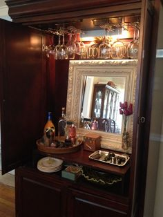 DIY- TV armoire transformed into entertaining bar cabinet!