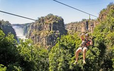 Known as the biggest waterfall in Africa, Victoria Falls is a playground for fun, adventure and adrenaline-filled activities for all ages. Located on the border between Zambia and Zimbabwe, this Natural Wonder of the World is described as the Smoke that thunders. From ziplining to game drives, this list provides the best adventures and experiences in Victoria Falls. #explorer #explorersafari #safari #africa #victoriafalls #zipline #bungee #10thingstodo #zimbabwe #zambia #adventure #bucketlist Zimbabwe Africa, Victoria Falls, Birds Eye View, Africa Travel, Natural Wonders, Wonders Of The World, Canopy, Safari, Things To Do