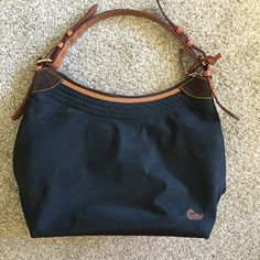 Dooney & Bourke Purse Fantastic purse! Barely used. Hot pink on the inside. Ask any questions. Dooney & Bourke Bags Shoulder Bags