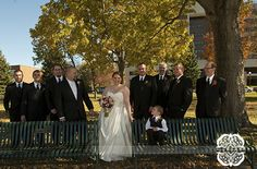I absolutely love this casual pose of the bride surrounded by her adoring groom and all the groomsmen.