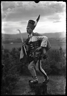 Mieczysław Cholewa posing on a stump with an alpenstock, wearing stylized traditional costume of highlanders from the Podhale region Highlanders, My Heritage, Folklore, Art Google, Ireland, Culture, Traditional, Costumes, Spaces