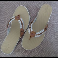 SPERRY FLIP-FLOPS Super cute SPERRY thong flip-flops. Leather and fabric upper in a sand color. Has a molded footbed for comfort. Sperry Shoes Sandals