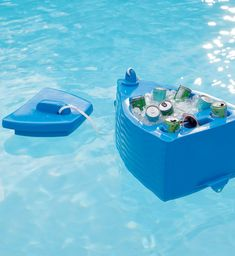 Made for fun in the sun: our Nassau Pool Cooler is crafted from thick, insulating foam to accommodate ice and up to twelve 12-oz. cans of your favorite beverage. Lid is securely attached by rope and built-in grommet allows you to tie off cooler (and keep it close) while you float. Small Cooler, Pool Cooler, Pool Organization, Floating Cooler, Pool Storage, Pool Accessories, Pool Builders, Pool Floats