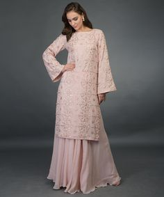 From our Wedding Festive Collection, this is a nude pink pure georgette sharara suit with intricate exquisite rose gold gota patti hand embroidery. The shirt has rose gold gota patti hand embroidery all over in lattice pattern. Indian Wedding Outfits, Pakistani Outfits, Indian Outfits, Eid Outfits, Ethnic Outfits, Sharara Designs, Kurti Designs Party Wear, Stylish Dress Designs, Designs For Dresses