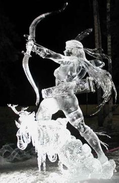 ice sculptures  (jeez not normally a big fan of this art form but I am stunned by this one--the hair alone...egad... kd)